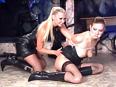 Leather, Lesbian, Lesbians in leather dresses with strappns