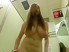 Natural, Mature and young lesbians in changing room